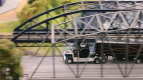 Big truck in motion. Miniature model top view stock video footage