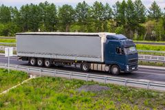 Truck moves on country highway. Big truck moves on country highway Royalty Free Stock Photo