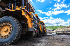 Big truck in open pit and blue sky Stock Images