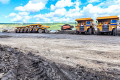 Big truck in open pit and blue sky Royalty Free Stock Images