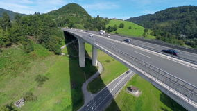 Big truck passing the camera on a bridge of a highway road. Aerial shoot of a big truck passing the camera on a big bridge of a highway road and motorway road stock video