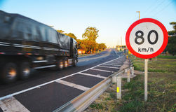 Big truck passing at high speed on road exceeding speed limits Stock Photos