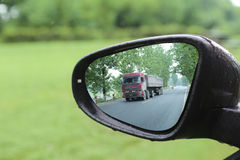Big truck reflected in rear mirror Royalty Free Stock Images