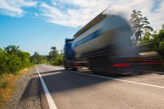 Big truck on the road. At full speed, blur royalty free stock image