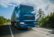 Big truck on the road. At full speed, blur stock image