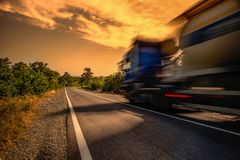 Big truck on the road. At full speed, blur stock photos