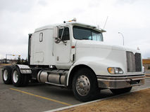 Big Truck - Tractor. Picture of a white truck / big rig in a parking lot. Right-side view Royalty Free Stock Image