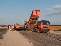 Truck unload bitumen. The big truck unload bitumen royalty free stock image