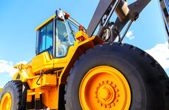 Big truck wheel closeup object. bulldozer closeup wheels sky sunny summer Royalty Free Stock Photo