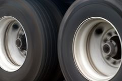 Big Truck Wheels. Some of the wheels of an 18-wheeler showing motion Stock Photo