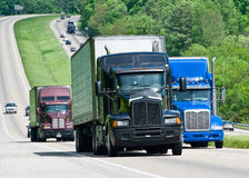 Trucks traveling along the highway Stock Photo