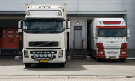 Big trucks at loading dock Royalty Free Stock Photo