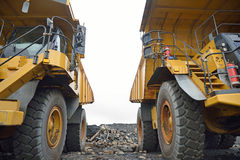 The big trucks. Two 130 ton tiptrucks waiting for work at an open cast coal mine, Westland, New Zealand royalty free stock photos