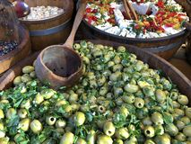 Big tub of olives on a market stall royalty free stock photography