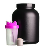 Big tub of whey protein with pink shaker and cup of protein Royalty Free Stock Photos