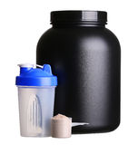 Big tub of whey protein with shaker and cup of protein powder. For bodybuilding isolated on white background royalty free stock photography