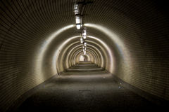 Big tunnel. Big dark tunnel with lamps Stock Image