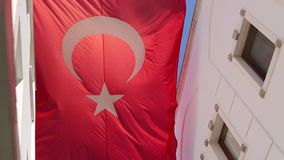 Big Turkish flag flying  on the background of blue sky. stock video footage