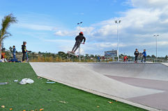 Skate Park - Jumping On Scooter Royalty Free Stock Photo