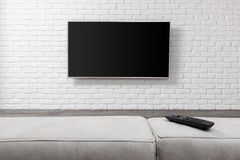 Big TV on the white wall. Living room led tv on white wall stock photos