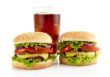 Big two cheeseburgers with glass of cola isolated on white Stock Image