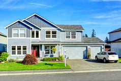 Big two story house. View of entance porch and garage. Light blue two story house with column entrance porch, garage and driveway view stock photo