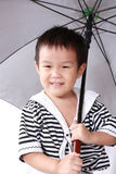 Big umbrella and little girl Stock Image