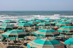 Big umbrellas. Photo of a beach full of big umbrellas Stock Photos