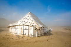 Big unusual tent in a sand storm in Spain Royalty Free Stock Photo