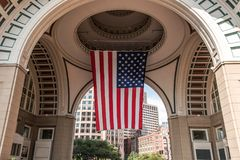 Big US american Stars and Stripes Flag Hanging from inside Dome in Boston Massachusetts on sunny day Stock Photos