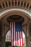Big US american Stars and Stripes Flag Hanging from inside Dome in Boston Massachusetts on sunny day Stock Photography