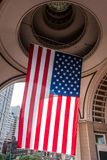 Big US american Stars and Stripes Flag Hanging from inside Dome in Boston Massachusetts on sunny day Stock Image