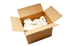Big Used Opened Box With Packing Paper. Nice big cardboard box with packing paper opened up ready for someone to start packing stuff and getting ready to move or Royalty Free Stock Image