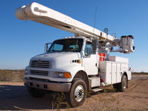 Big Utility Truck. A large utility truck sitting in the Arizona desert waiting to be used Stock Image