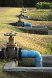 Valve for shutting off in waste-water treatment pond. Big valve gate for shutting off in waste-water treatment pond royalty free stock photography
