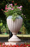 Big vase in park. Big vase with flowes in a city park Royalty Free Stock Photos