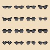 Big vector set of icons of different shapes sunglasses in trendy flat style. Stock Image