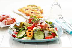 Big vegetable salad with prosciutto Stock Images