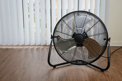 Big ventilation fan on wooden floor Royalty Free Stock Image