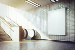 Big vertical blank billboard with escalator. White billboard mockup underground metro with escalator Stock Images