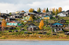 Big village on a hill over the river Stock Images