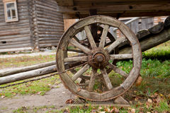 Big vintage rustic wooden wagon wheel. In Museum of Russian Wooden Architecture Vitoslavlitsy near Veliky Novgorod, Russia Stock Photo