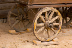 Big vintage rustic wooden wagon wheels stock images