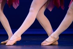 Big W made of feet of lyrical dancers Stock Photo
