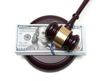 Big wad of money and gavel closeup isolated on a white backgroun Royalty Free Stock Images