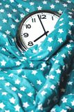 Big wall clock in a blue bed stock images