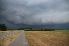 Big wall cloud above the fields in Overijssel in the Netherlands with thunderstorms coming up. Big wall cloud above the fields in Overijssel in the Netherlands stock photography