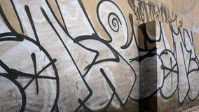 Brown graffiti wall two blocks royalty free stock photography