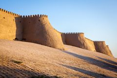 Big walls of ancient Khiva City. Khorezm Region, Uzbekistan, Middle Asia. Soft light during sunset stock photo