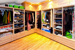 Big wardrobe. Big built in wardrobe room with open shelves Stock Image